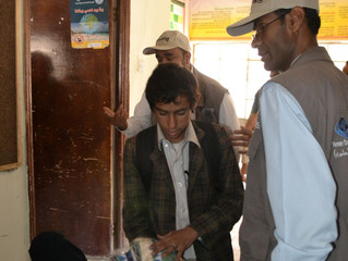 Orphans and disabled in Sana'a received school bags and winter clothing