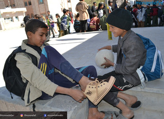 Monareliefye.org providing 800 orphan students pair of shoes for each student at Sana'a House Or