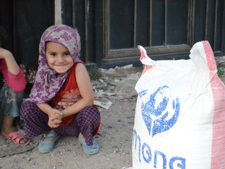 Monareliefye.org delivering needy families in Bani al-Harith area 70 food baskets in Sana'a
