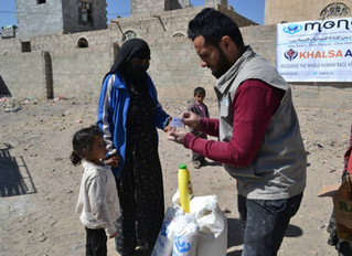 Monareliefye.org delivering food aid packages in Sanaa funded by the UK based charity Khalsa Aid.