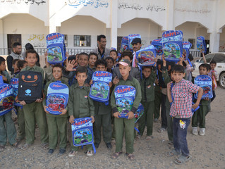 Monareliefye.org continues for the second day distributing school bags to orphan students in Sanaa