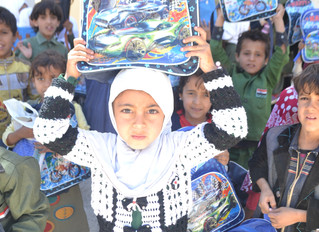 Monareliefye.org delivered 200 orphan students school backpacks in Sana'a