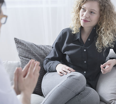 Client in therapy office - link to blog