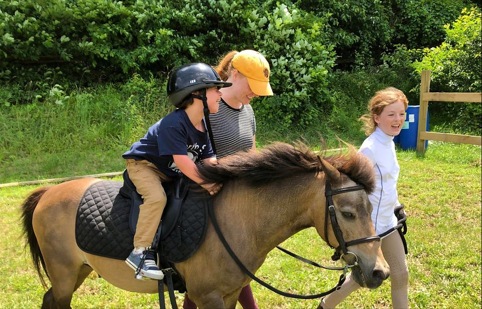 James laughing therapeutic riding June 2