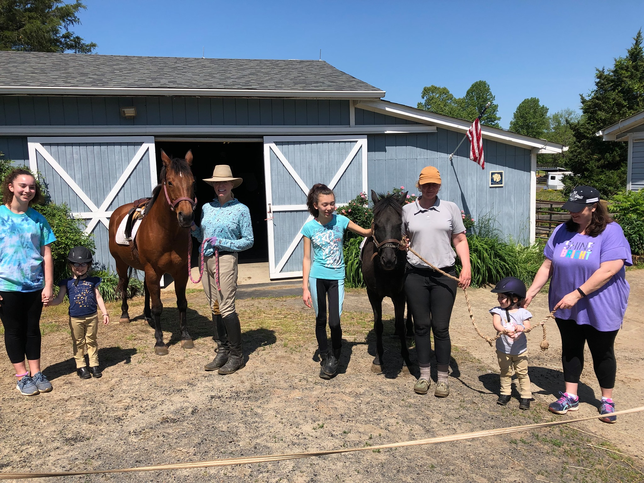 Volunteers Outside Barn Spring 2019