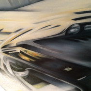 """The Dino. [56"""" x 92""""]; oil. 2014-2015  Aerodynamic movements and countering forces of highly advanced engineering and machinery are conveyed in a highly technical, abstract expression. While some of the influences of futurism and cubism can be seen, the 'supreme abstraction' platform in which the artist operates connects the [often layered] movements in a continuous flowing form. Connected to the movements of the car, its natural and environmental forces is a highly abstracted Ferrari horse in motion at the bottom right corner. Top right, there are three layers of movements, as  circles diffuse out amidst two other aerodynamic movements. The yellow stripes in the road lift off in motion and fade into the soft yellow DINO logo on the hood.  The Dino conveys all surrounding energies and elements of physics and as they interact with the engineered force and highly aesthetic, vintage form and contour of the rare, limited edition model, Dino Ferrari (246 GTS model).   FERRARI Historical note:  The history of this model has an intimate yet tragic sentiment story to it:   Alfredo """"Dino"""" Ferrari died from Duchenne Muscular Dystrophy 60 years ago. Alfredo Ferrari (1932-1956) was an Italian automotive engineer and the first son of automaker Enzo Ferrari. Alfredo was nicknamed Dino. He had Duchenne muscular dystrophy and died at the age of 24.  Named to honour Ferrari founder Enzo Ferrari's son and heir Dino Ferrari, the Dino models are a rare edition and coveted by car aficionados."""
