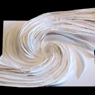 """DIFFUSION SERIES #1: 'Spiral' mixed media [sculpted canvas] 48"""" x 60"""" x 18"""" 2008-2009  Intertwining of forces, empowered by a monochromatic color scheme. This 20-month project involves intense three-dimensional sculpting of contours to convey such force."""