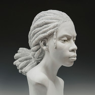 """22""""L x 20""""W x 22""""H Painted Resin 2019-2020 [TEMPORARY: Will provide edited version of this....]  A bust detail of the 'DREAM CONTINUED' girl with the world of opportunity in her hands. Taking us all back to [our] childhood times when things were simple, and all kids could play the most simple of playground games. A beautiful accepting and co-existence of children living, playing and loving each other. The girl has aged slightly from the core DREAM CONTINUED sculpture in which she is playing jacks with the other children. She has a reflective yet focused look on her face, deep in thought. What does she know about the [historical] past and present inequalities, challenges and flaws and what would she like different in the future? What are her thoughts and dreams and how have they changed with what she's been exposed to in society? What would she like different?   With the core narrative of the work referencing equality, unity, peace and love, the heart and mind of the audience that the work is inspired by and intended for comes to light: children and future generations.  The notion of thinking more like children is implored as creating a more beautiful world of not opportunity for all and of unlimited potential as a human race.  ('Amani': a name which means wishes, desires, aspirations and dreams to promote peace.)"""