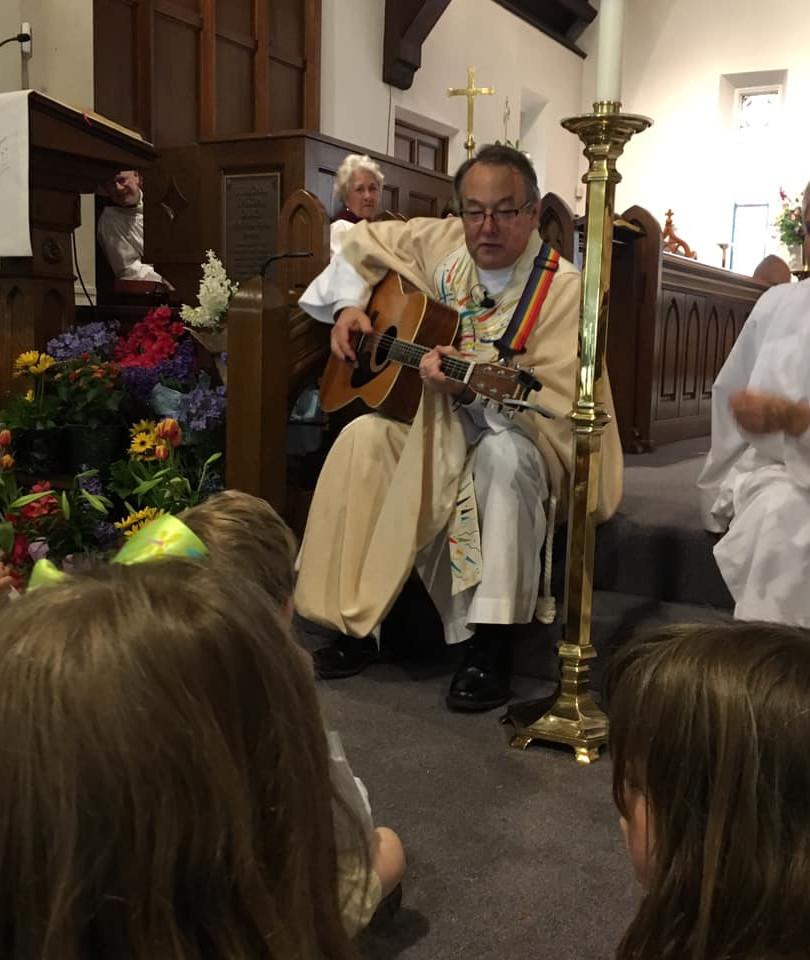 Herbert strumming away during Children's Sermon