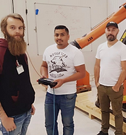 A group of people during a robot programming course