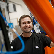 A service engineer working with robots for surface treatment