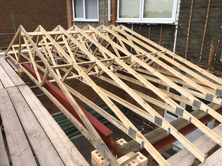 Roof trusses on for new garage roof