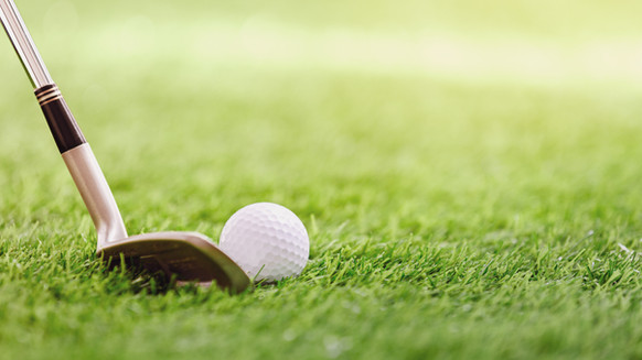 Club de golf et balle