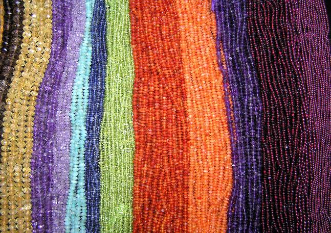Strings of semi-precious stone beads