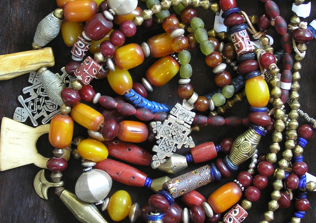 Assorted trade beads, pendants and African 'amber'