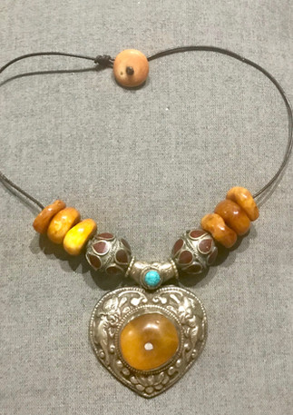 Pressed amber and pendant from Nepal