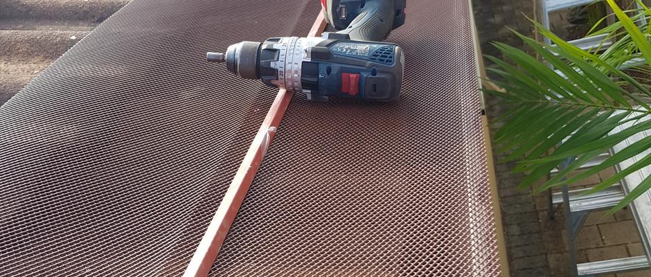 Gutter mesh install (during)