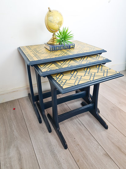 a slight side view of the mid century nest of tables