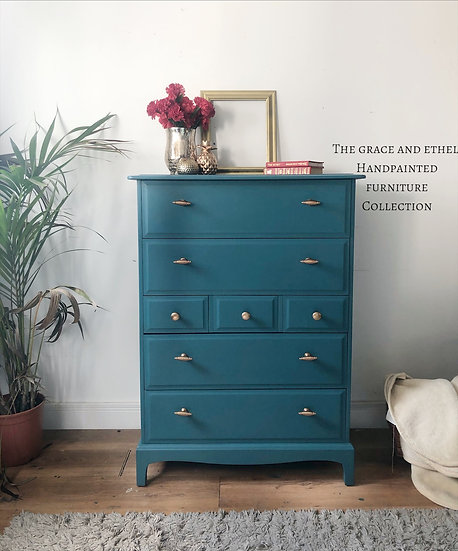 a set of stag minstrel tallboy 7 drawer chest of drawers 4 large drawers and 3 smaller drawers that are places in the middle