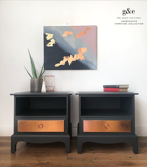 a front view of a pair of one drawer stag bedside cabinets with a shelf area painted in dark grey and copper metal leaf