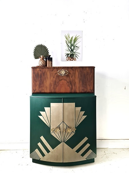 a front view of the green cocktail cabinet with a art deco design in gold