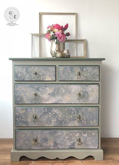 a set of sage green pine chest of drawers with 2 small drawers and 3 larger drawers. with a sponged design