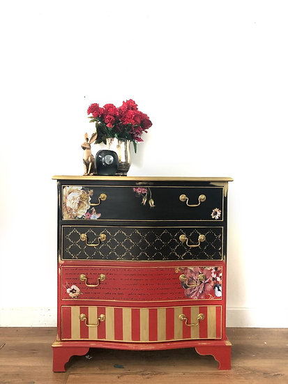 a set of black and red blended design with floral designs and gold strips