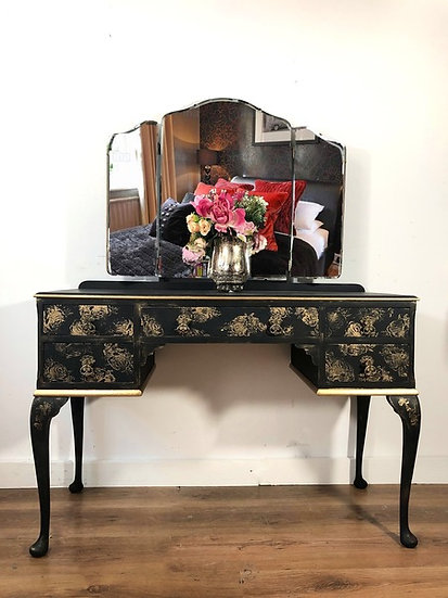 a front view of a vinatge dressing table with 5 drawers and queen anne style legs with a triple mirrro