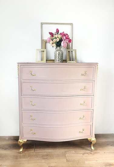 a dusky pink french louis 5 drawer chest of drawers with gold legs
