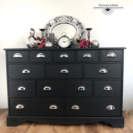 a set of 16 drawer merchants chest painted in black with silver cuphandles