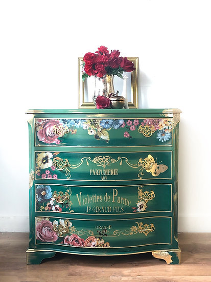 a set of serpentine chest of drawers with 4 drawers painted in two shades of green that have been blended together and floral