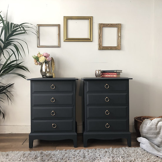 a front view of a pair of dark grey 4 drawer stag minstrel bedside cabinets