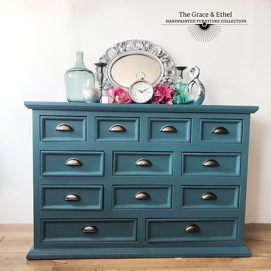 a set of 12 drawer merchant chest in a blue tone with silver cup handles