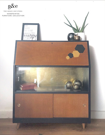 navy and natural wood mid century modern bureau , with sliding glass doors, wooden sliding doors , and a desk area