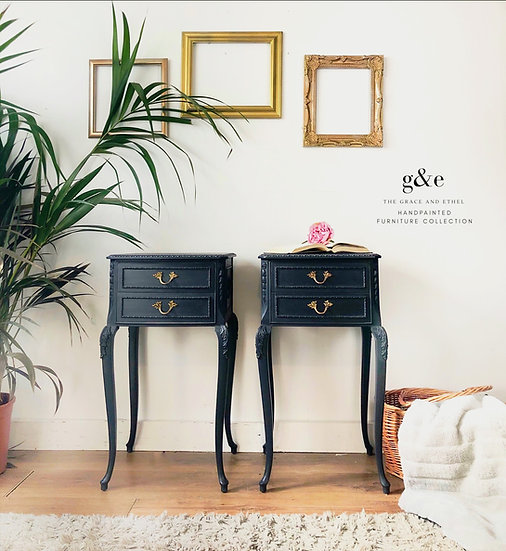 a pair of dark grey french louis two drawe bedside cabinets