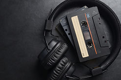 headphones-and-compact-cassettes-on-blac