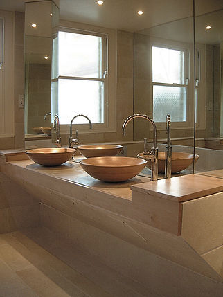 Bathroom style. Clean & minimal style. Simple living. Easy bathrooms. Wet room style. Calm & neutral bathrooms. Contemporary minimalist style bathroom. Pair of wood countertop basins on bespoke stone double washstand. Mirrored bathroom walls. Concealed laundry bins. Sandblasted glass window.