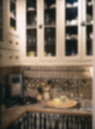 Compact spaces. Living with high ceilings. Provencal style. Kitchen inspiration. Unusual kitchens. French kitchens. Recycled home. Kitchens with character and charm. French architectural salvage kitchen. Glass fronted cabinets and spice drawers. French black & beige curtains concealing appliances. Support saucisson used for kitchen hanging. Large cups & saucers