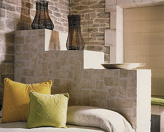 Romantic bedrooms. Compact living. Creating usable space in a small bedroom. Greek style bedroom. Clean & minimal interiors. Inspirational interiors. Bespoke stone bed with concealed storage. Vintage wine strainers converted to uplighters. Yellow and lime green velvet cushions