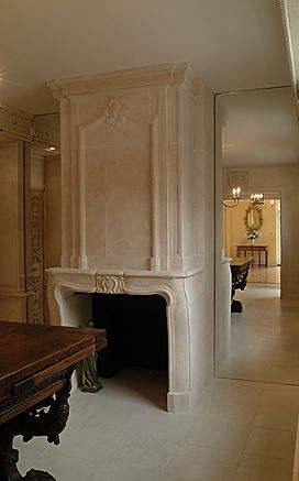 Cheminee en trumeau. Period French fireplace in stone. Floor-to-ceiling mirrors. Stone floor.