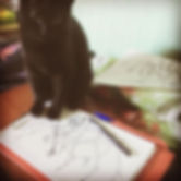 Cat on artwork