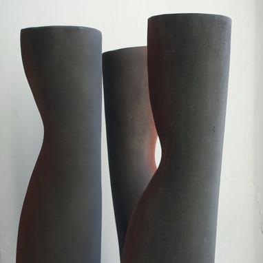 Dark tall vases