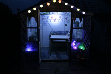 summerhouse at night in the garden