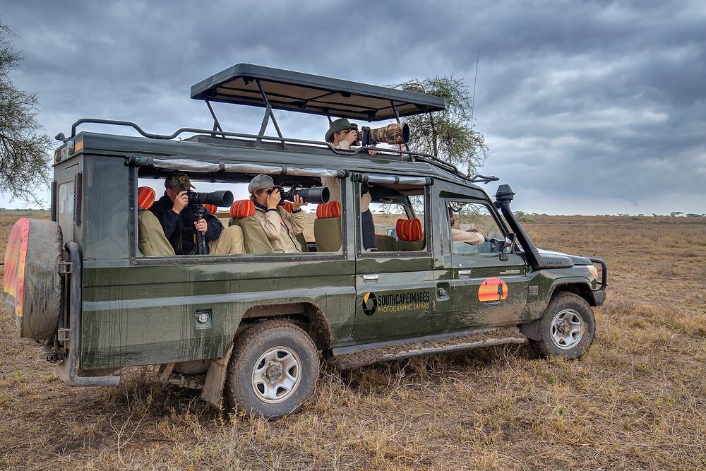 Photographers in a safari vehicle in Serengeti