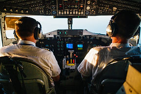 two-pilots-flying-an-airplane-2898316.jp