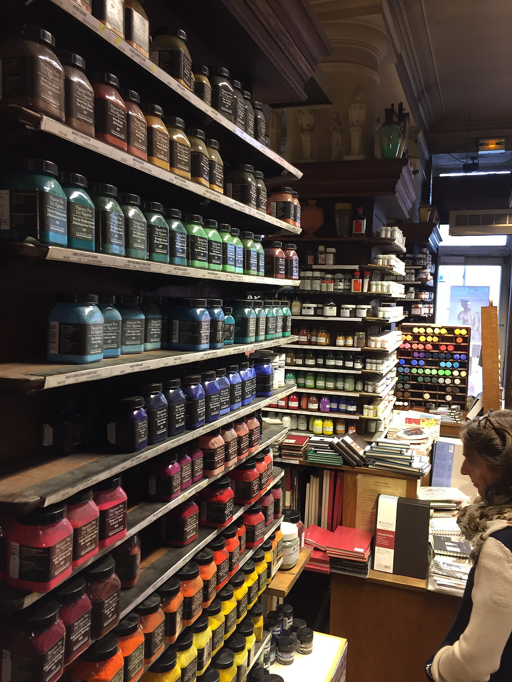 Magasin Sennelier, art store in Paris, with views of shelves of colored powders (pigments to be mixed into paints).