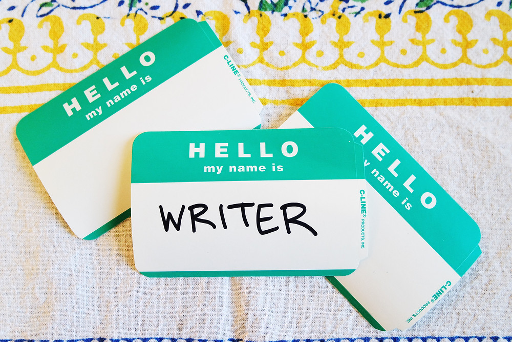 Hello My Name Is stickers. The front one says WRITER.