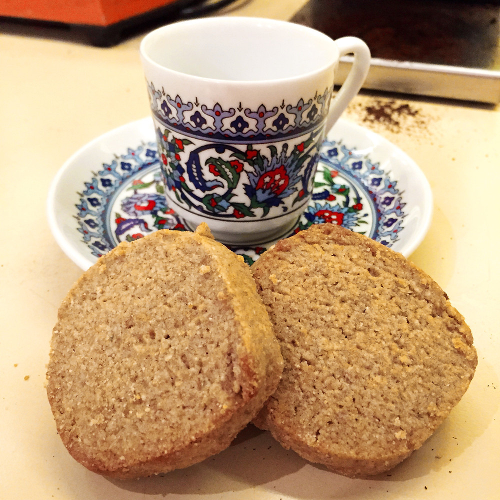 Two rye cookies and a blue and white patterned Turkish demitasse cup and saucer.