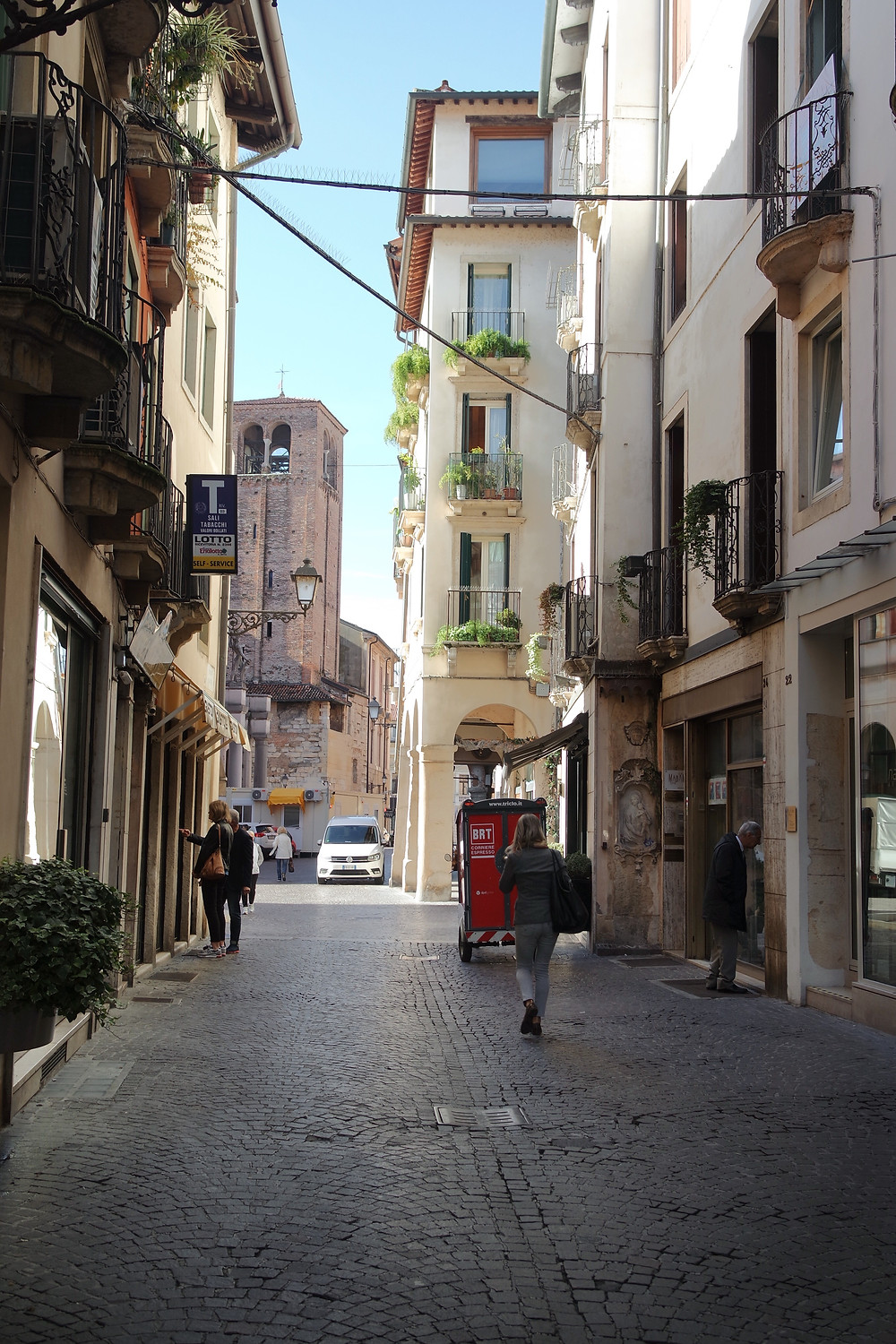 Narrow street in Vicenza on a sunny day.