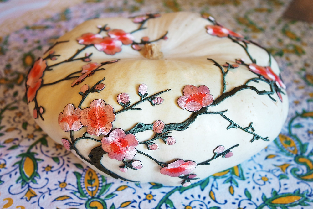 White pumpkin with pink floral applique.